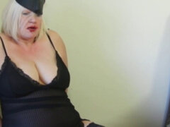 Bound and gagged grandma Lacey Starr. Bound and gagged grandma Lacey Starr gets pussy toyed by lesbian domina